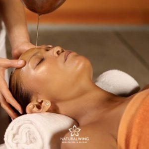 Head massage with Warm Oil Natural Wing Spa Resort Samui